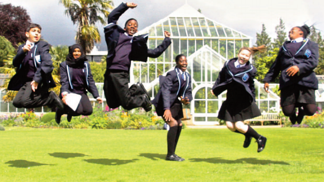 image of pupils jumping in the air excitedly