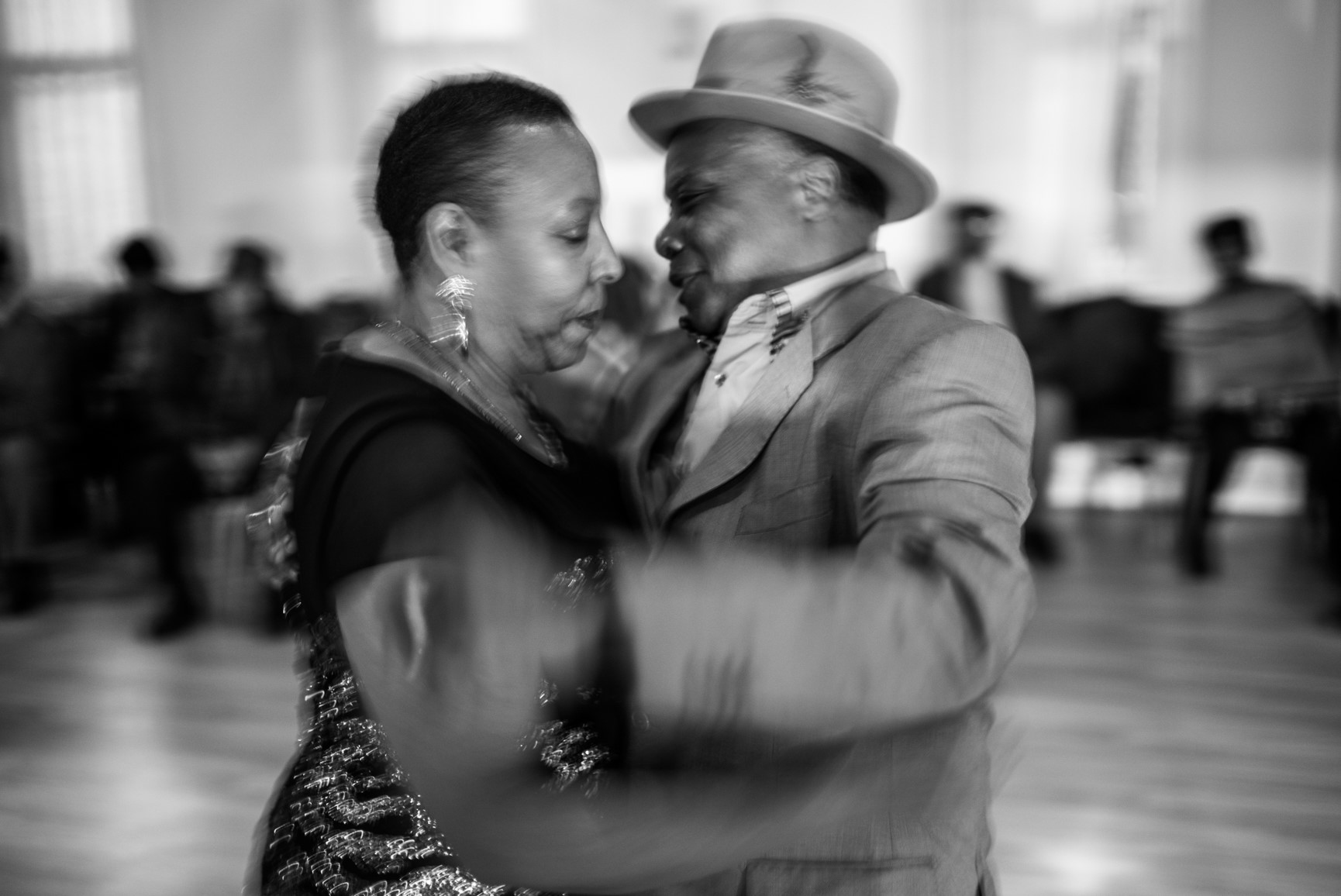 B&W photo of older couple dancing - from the Windrush Generation exhibition