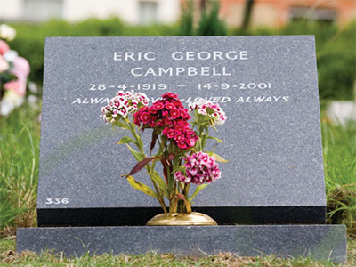 Image of a cremation memorial stone and flowers