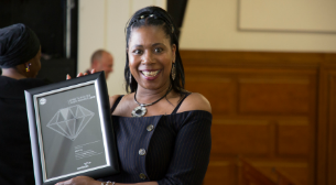 A foster carer with their award