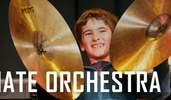 Animate orchestra half-term course - child playing cymbals