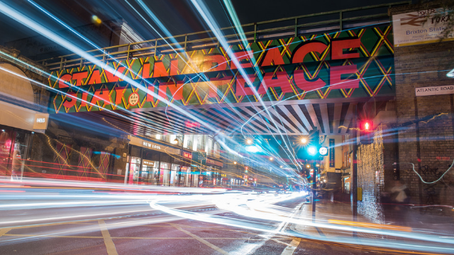 Picture of bridge in Brixton 'stay in peace' design at night