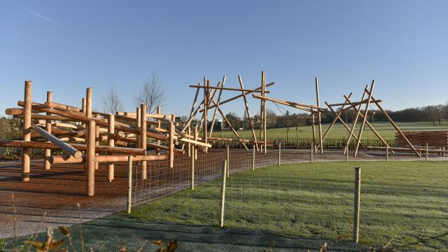 Wooden climbing frames on a bright and sunny day